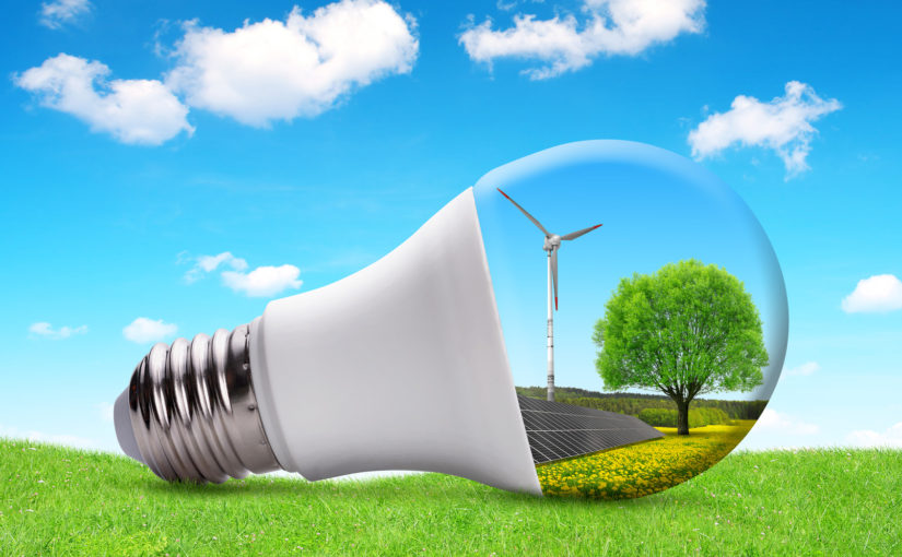 Eco LED bulb with solar panel and wind turbine. The concept of sustainable resources.